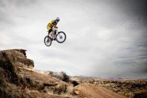 Man riding a dirt bike on an OHV trail