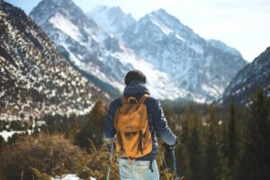 Man facing the alps while on a hike